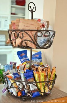 Put snack items, breakfast items, or lunch items in a pretty tiered bin or basket for easy access.