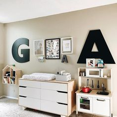 @sofreshandsochic on Instagram // Scandinavian style kids room with a gallery wall featuring large letters from @landofnod and furniture from @ikea. // www.sofreshandsochic.com