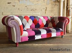 Modern British and handmade bold berry Patchwork Chesterfield Sofa. Totally unique fabric 3 seater, shown in a range of purple and red hue colours. | Abode Sofas
