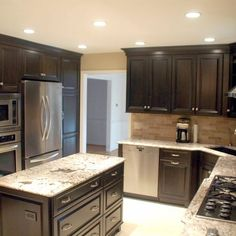 Love the Black Cabinets to the Ceiling and the can lights.