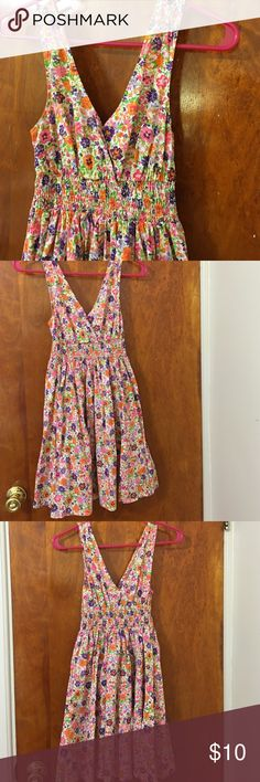 💐 Garden Party Dress 💐 Flowy sundress with beautiful flower print. Low neckline and back with runched waist. Hits mid-thigh to just above the knee. Perfect for a sunny day or tropical getaway! Divided Dresses