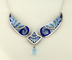 Look at this pretty angel wing necklace! Three separate pieces of champleve enamels frame your neckline and the blue topaz drop adds sparkle! Metal Clay Jewelry, Enamel Jewelry, Glass Jewelry, Jewelry Art, Antique Jewelry, Jewelry Accessories, Fine Jewelry, Jewelry Design, Amber Jewelry