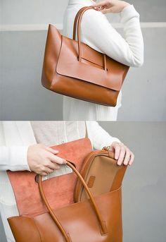 Cross body Bag, Shoulder Bag, Handbag Long Adjustable Shoulder Strap. Signature metal feet adorn bottom. Inside a pocket Length: 39cm; Height: 26cm; Width: 13cm; Color: Red / Black / Brown / Grey