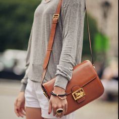 Ysl ring. Tan bag love.