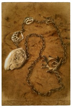 Bear came across with a reindeer... -silver necklace. Jewellery made by Tytti Bräysy