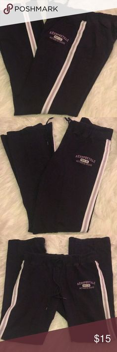 "Aero Sweatpants Navy Blue pants, with purple/white stripes down the side of the legs. Great condition, no strains, tears, or notice of wear at all, since I don't think they have ever been worn. Length: 31"" Aeropostale Pants Track Pants & Joggers"