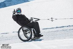 Yes, those are ski-blades attached to the wheelchair. How cool (heh!) is that?