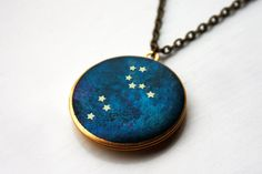 LEO: July 23 -August 21  An original illustration by Louisa Marsh that has been carefully hand applied to an antique brass locket.  The locket opens