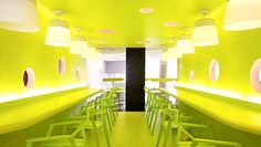 It is a university located in Bangkok, Thailand Student's workshop shelters. A fluorescent green makes the interior looks unique and stylish. However, I don't think it creates a comfortable and relaxing  ambience for people who stay here for a long time although the design is fashionable. It's because this color is very intensive.