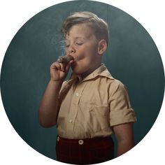 """""""Smoking Kids"""" by Frieke Janssen.     """"To assure you of the safety of the children, there were no real cigarettes on set. Instead, chalk and sticks of cheese were the prop stand ins, while candles and incense provided the wisps of smoke.""""    The girl knows how to Photoshop."""