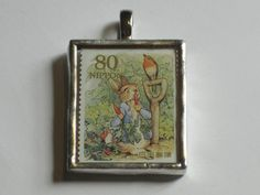 I really might have to keep this one for myself. | Postage Stamp Pendant by bookshelvesofdoom, $16.00