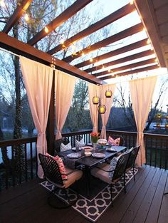 Jazz up your Trex Pergola with outdoor curtains. We love how they add a bit of privacy and a lot of elegance to this backyard deck. The lights strung on the pergola complete the picture. Outdoor Rooms, Outdoor Living, Outdoor Patios, Outdoor Kitchens, Outdoor Life, Indoor Outdoor, Diy Cement Planters, Cement Patio, Gazebos