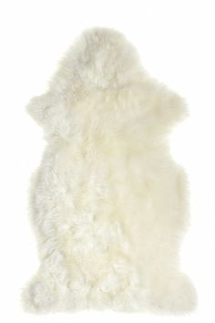 SHEEP SKIN RUG - I would like to put a couple of these in front of the shelves for an extra cozy play space.