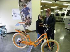 """Doug & Olive picked out two new Pedego Electric Bikes!  Doug & Olive picking up their new Pedegos. They chose a Black and a Ruby Red 24"""" Step Thru. Have Fun!!!  Doug chose black and Olive selected a Ruby Red 24"""" Step Thru."""