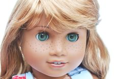 Custom Sonali Mold Doll with grey eyes, custom painted freckles and strawberry blonde wig.