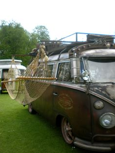VW Camper Van with Hammock attached to the side.