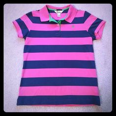 Lilly Pulitzer Shrunken Striped Polo Shirt Navy and pink striped island polo. Lime green palm tree accent. This is the shrunken polo and runs pretty small! In great condition. Lilly Pulitzer Tops