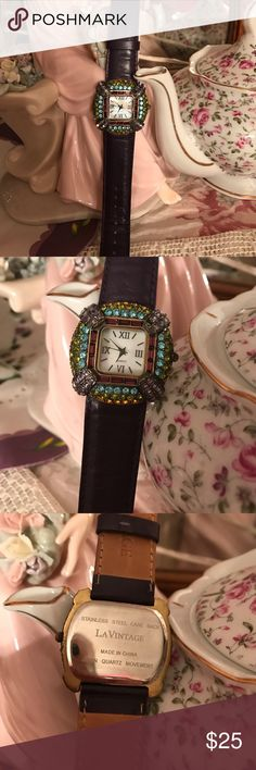 Watch Beautiful watch with a genuine leather strap, and faux gemstones. Colors are peridot, amethyst, blue topaz, and citrine. The strap is a deep plum shade. Bought from QVC many years ago, and is in like new condition, since haven't worn very much. It does need a battery, which can be purchased at Walmart. La Vintage Jewelry