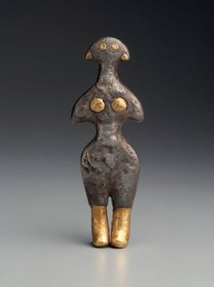 2500–2300 BCE. Female Figurine Holding her Breasts (goddess), Anatolia ancient Turkey, cold hammered silver with gold inlays in the eyes, ears and breasts, and gold leaf boots. No find spot. MFA.