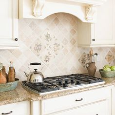 Kitchen Backsplash Ideas: like the creamy & tan tile and countertops against the white cabinets
