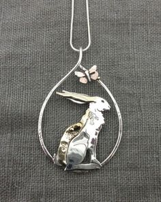 Hare & Moth Pendant in silver, gold & copper.