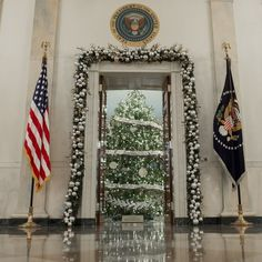 The White House Christmas Tree in the Blue Room and decorations are seen from the Grand Foyer.