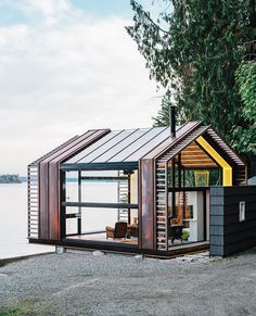 Pavilion overlooking the shores of Puget Sound on Vashon Island, about 20 miles southwest of Seattle. Standing-seam copper siding accentuates sections of the structure that provide shear support for the steel moment frame. Vashon Island, Haus Am See, Home Fashion, Exterior Design, Design Garage, Interior Architecture, Tiny House, Mcm House, House Wall