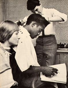 Sammy Davis Jr getting his hair tuned up!