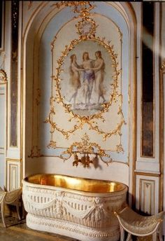 Bath niche of Marie Antoinette's sister, Caroline Matilda, Queen of Naples. Located in the Royal Palace of Caserta Campagnia. More views at www.localidautore.comarie     Baignoire (bathtub) . Note the delicate gilded paneling, and swags and bows on the tub are characteristic of Marie Antoinette's taste, which influenced the style of her time.