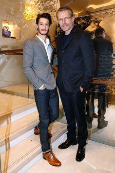 Pierre Niney & Lambert Wilson - New Boutique 77 avenue des Champs-Elysées (Credit:Getty Images) - December 4th 2014