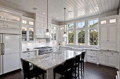 White Kitchen, dark hardwood, bianco antico granite tops, Keynes Prism Pendants - Lots of light - Borges Brooks Builders