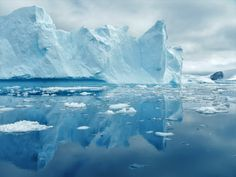 Iceberg Reflection in Antarctica - This beautiful summer landscape in Antarctica was seen in December 2016 when the ice was melting