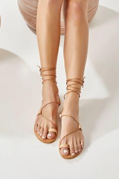 The perfect pair of gladiator sandals for minimalist lovers. Anastasia flats are handmade of top quality leather feature flattering slim cords that wrap around the instep and ankle. They set on a lightweight anti-slip rubber outsole that offers comfort for all-day wear. These nude sandals are great for elevating summer casual outfits. Greek Chic Handmades sandals are handcrafted in Athens, Greece and designed to accompany you everywhere. Find your perfect pair of beautiful Greek sandals. Toe Ring Sandals, Nude Sandals, Ankle Wrap Sandals, Black Sandals, Lace Up Sandals, Gladiator Sandals, Toe Rings, Greek Sandals, Tan Leather Sandals