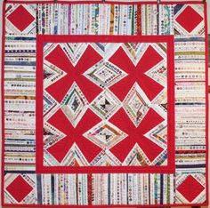 Selvage Blog: Red Zinger selvage quilt by Bari Berger of Missouri.