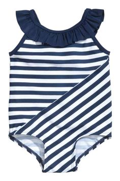 Patterned swimsuit: Swimsuit with frills on the shoulder straps and a decorative bow at the back. Lined front and gusset.