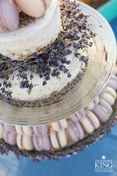 A lavender wedding macaron tower with semi naked lavender and poppy seed wedding…