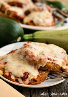 Zucchini Parmesan - Wondering what to do with those huge zucchini growing in your garden? This is the perfect, delicious recipe!