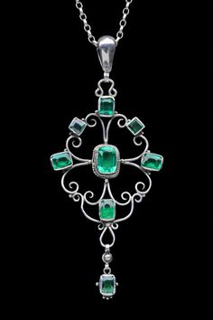 ARTHUR GASKIN 1862-1928  GEORGIE GASKIN 1866-1934. Arts  Crafts Pendant:  Silver  Emerald Paste. H: 9 cm (3.54 in); W: 3.9 cm (1.54 in)   British, c.1917  (Ref: 3915)