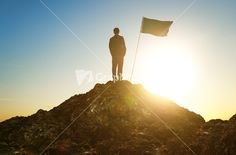 Download business, success, leadership, achievement and people concept - silhouette of businessman with flag on mountain top over sky and sun light background Stock Image and other stock images, photos, icons, vectors, backgrounds, textures and more.