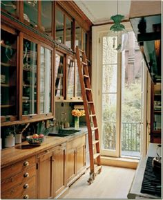 the library-inspired kitchen! I really hated to get out the ladder everytime I need to get something from those top cabinets. love this idea!