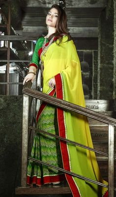 Iconize your ethnic style by dressing into this green and yellow georgette half n half sari. You are able to see some intriguing patterns completed with lace and stones work. Upon request we can make round front/back neck and short 6 inches sleeves regular saree blouse also. #NewPrintedDesignerSarees