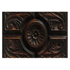 This tempered glass cutting board is decorated with a photographic image of a beautiful artistic wood carving. A central abstract circular flower pattern has petals radiating out to a carved circle which is surrounded by four sections. Each section has abstract leaf carvings. #wood #carving #kitchen
