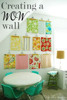 use hangers to display fabric (strip of cardboard across top, to avoid drooping fabric corners)