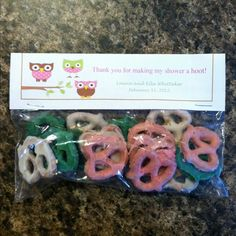 Owl baby girl shower favors! I used the colors of the shower for the pretzels.