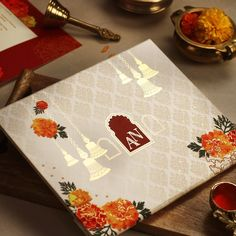 This design combines the traditional symbols of an Indian Wedding Ceremony like Brass Bells and strings of Marigolds with a modern layout. This is a folder style invite with inserts & gold foiling is used to enhance the Brass Bells. Hindu Wedding Cards, Indian Wedding Invitation Cards, Indian Wedding Ceremony, Creative Wedding Invitations, Hindu Weddings, Wedding Mandap, Wedding Stage, Wedding Receptions, Wedding Stationery