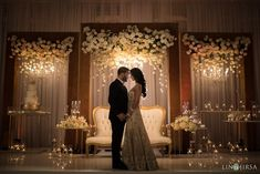 Ivory flowers in a gold frame for reception maharani wedding stage backdrop deco. Wedding Ceremony Ideas, Indian Wedding Receptions, Wedding Stage Design, Wedding Reception Backdrop, Wedding Mandap, Wedding Stage Decorations, Wedding Designs, Wedding Table, Wedding Cakes