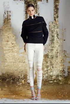 Fitted metallic coated pant that features diagonal panels of laser cut strips on front. Strips run horizontally across the leg for added stretch. Pant opens at centre front with a fly/zipper opening.