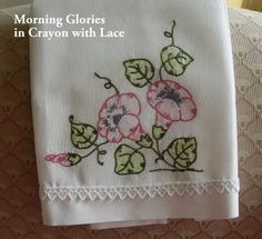 How to embellish embroidery by coloring with crayons and heat-setting; will try this.
