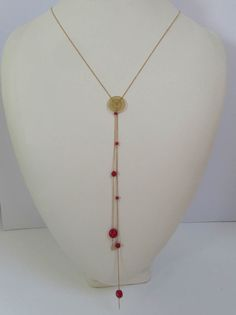 Helios Feather Necklace in coral, 14K Gold Filled Chain and feather charms  Available at:  www.oncefound.co.uk