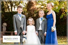 Group photo of kids at The Priory Hotel, Hereford in October sunshine with blue cravats and bridesmaid's dress